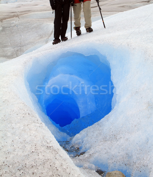 Standing Over Glacier Tunnel Stock photo © eldadcarin