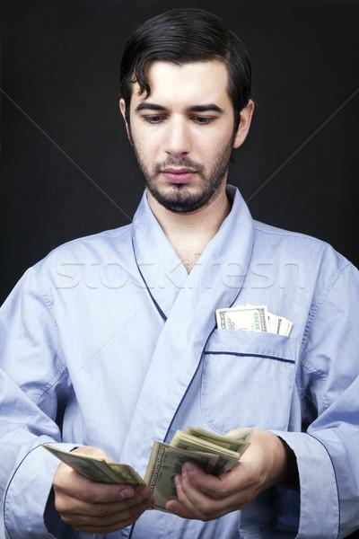 Cash home shot volwassen man Stockfoto © eldadcarin
