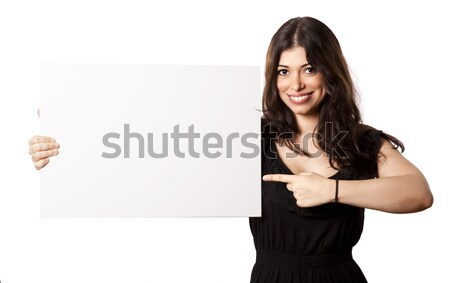 Isolated Happy Woman Pointing at Sign Stock photo © eldadcarin