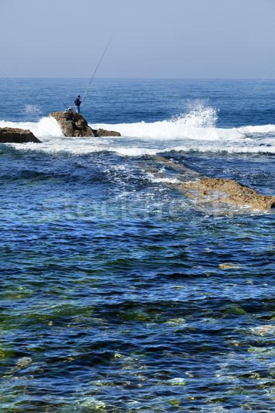 Fisherman Amongst the Waves Stock photo © eldadcarin