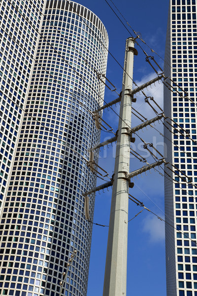 Stock fotó: Felhőkarcolók · nagyfeszültség · elektromosság · három · város · ablak