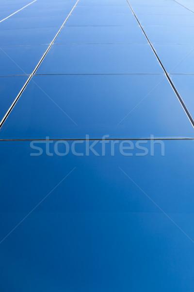 Diminuendo sipario muro edifici per uffici vetro cielo blu Foto d'archivio © eldadcarin