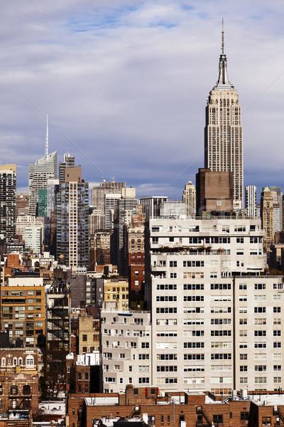 Empire State Building Manhattan sziluett szoros gyülekezet felhőkarcolók Stock fotó © eldadcarin