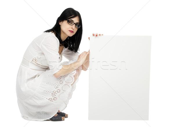 Summer Dress Woman Crouching Next to Sign Stock photo © eldadcarin
