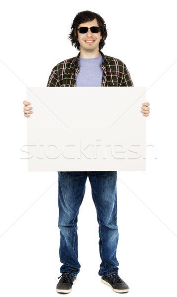 Smiling Casual 30's Guy with Sunglasses Holding Sign Stock photo © eldadcarin