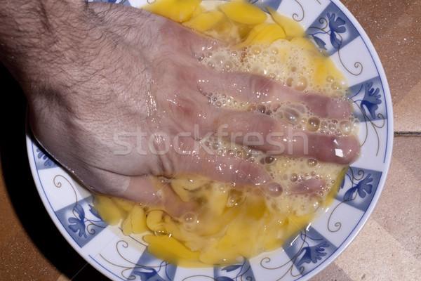 Kéz tojás tojássárgája tányér Stock fotó © eldadcarin