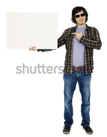 Smiling Casual 30's Guy Holding Sign Stock photo © eldadcarin