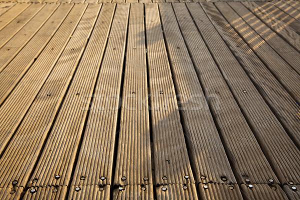Sunlit Wooden Deck Stock photo © eldadcarin