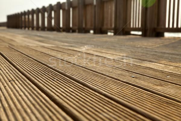 Deck percorso legno luce del sole diminuendo legno Foto d'archivio © eldadcarin