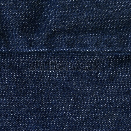 Denim Fabric Texture - Dark Blue With Seam Stock photo © eldadcarin