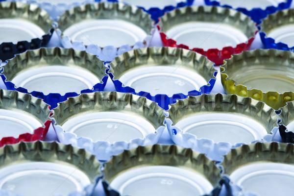 Metal pięć butelki do góry nogami tle Zdjęcia stock © eldadcarin