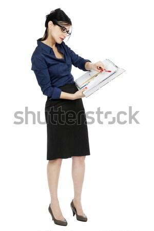 деловой женщины указывая документа взрослый рано 30-х годов Сток-фото © eldadcarin