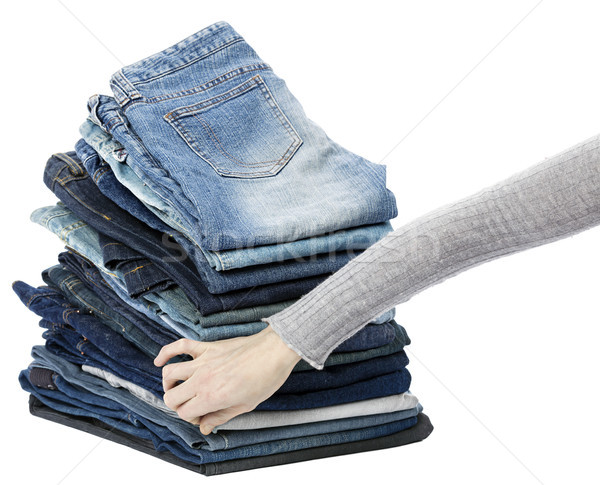 Hand Arranging Jeans Stack Stock photo © eldadcarin