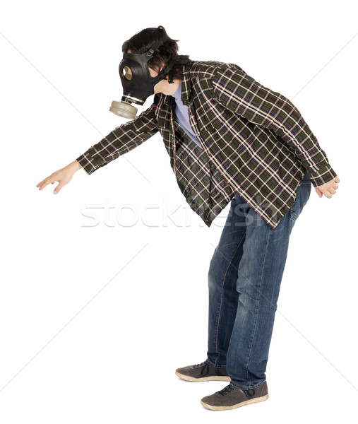 Isolated Man Wearing Gas Mask and Reaching Stock photo © eldadcarin