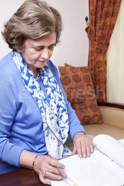 Senior Businesswoman about to Write Stock photo © eldadcarin
