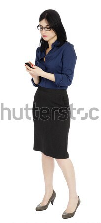 Business Woman Looking at Cellular Phone Stock photo © eldadcarin