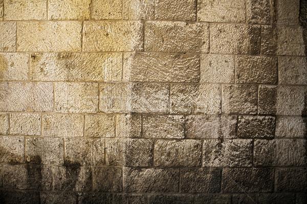 Sunlit Stone Wall Background Stock photo © eldadcarin