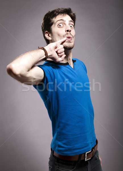 Grappig jonge man kaukasisch man Stockfoto © eldadcarin