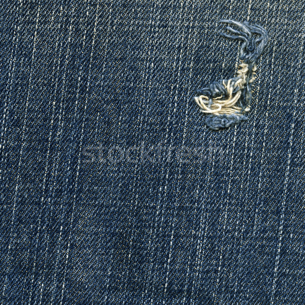 Denim Fabric Texture - Ripped Worn Out Blue Stock photo © eldadcarin