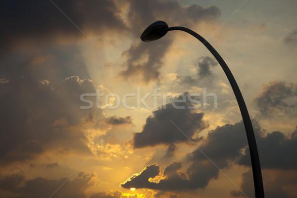 Street Lamp Silhouette & Setting Sun Stock photo © eldadcarin
