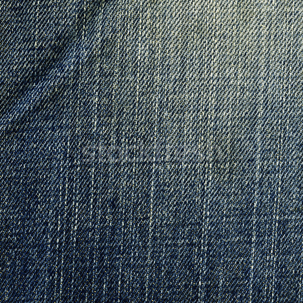 Denim Fabric Texture - Worn Out Blue Stock photo © eldadcarin
