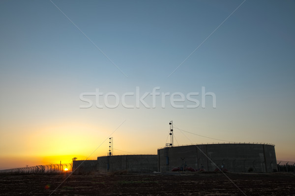 Agricultural Water Tanks at Sunset Stock photo © eldadcarin
