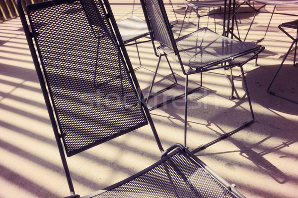 Metal Mesh Chairs and Stripes of Sunlight Stock photo © eldadcarin