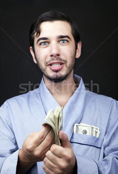 Gyártmány pénz köntös közelkép felnőtt férfi Stock fotó © eldadcarin