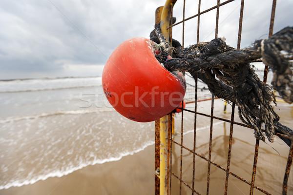 Winter Beach Buoy and Fence Stock photo © eldadcarin