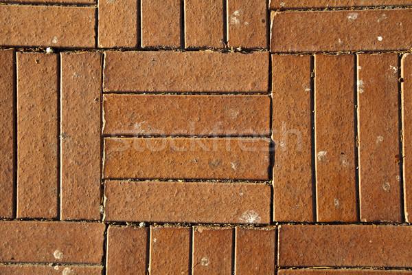 Sunny Red Brick Tiled Floor Background - Close Up Stock photo © eldadcarin