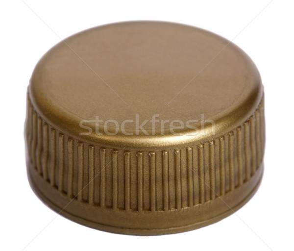 Isolated Gold Plastic Cap Stock photo © eldadcarin