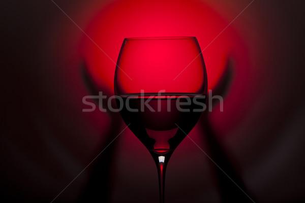 Vetro vino rosso mani rosso nero tenere Foto d'archivio © Elegies