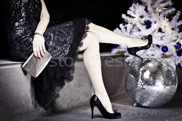Tempo di festa donna vestito nero scarpe albero di natale Foto d'archivio © Elegies