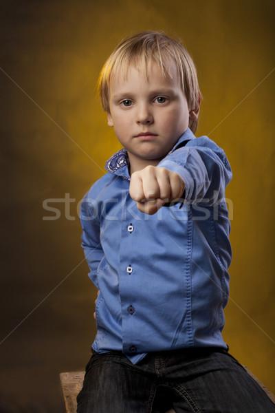 Ragazzo mano pugno seriamente piccolo Foto d'archivio © Elegies