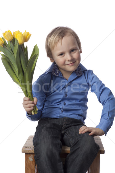 Fiú tulipánok néz kamerába citromsárga közvetlenül Stock fotó © Elegies