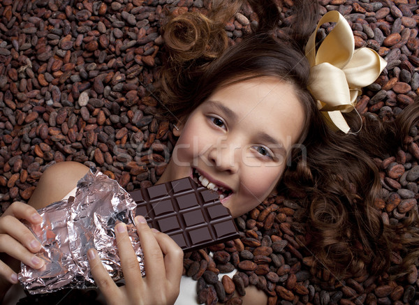 girl with chocolate on a cocoa beans Stock photo © Elegies