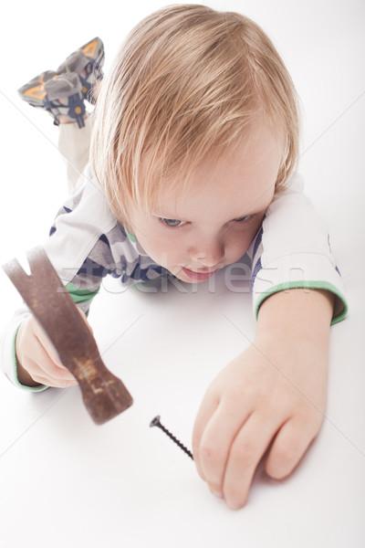 Ragazzo martello chiodo guardando isolato Foto d'archivio © Elegies