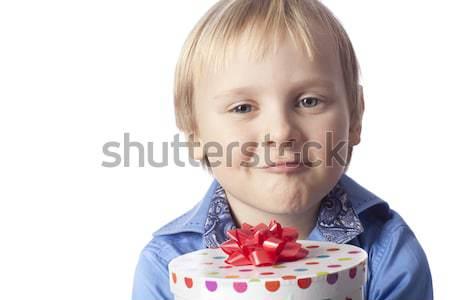 Sorridere ragazzo presenti isolato bianco bambino Foto d'archivio © Elegies
