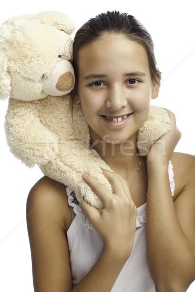 Gülen kız oyuncak beyaz ayı boyun Stok fotoğraf © Elegies