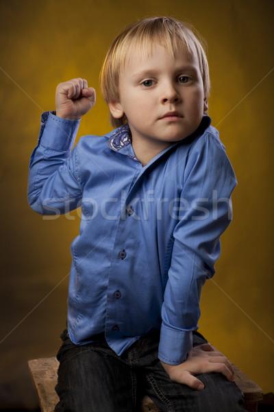 Erkek yumruk mavi gömlek siyah pantolon Stok fotoğraf © Elegies