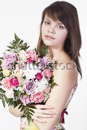 Genç kadın çiçekler yalıtılmış gülen kafkas buket Stok fotoğraf © Elegies