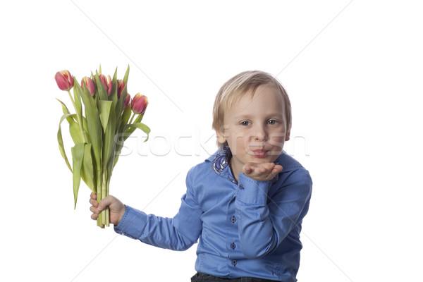 Ragazzo inviare farfalla bacio arancione tulipani Foto d'archivio © Elegies
