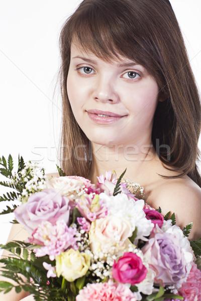 Genç gülümseyen kadın çiçekler gülen kafkas genç kadın Stok fotoğraf © Elegies