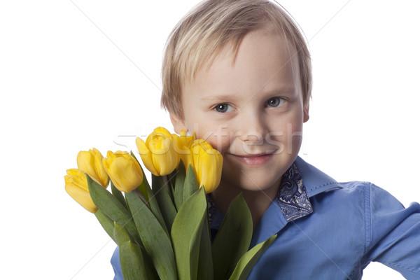 Ragazzo giallo tulipani guardando Foto d'archivio © Elegies