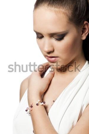 Bella ragazza guardando verso il basso bella giovane ragazza bianco donna Foto d'archivio © Elegies