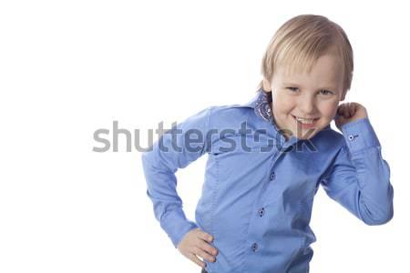 Sorridere ragazzo isolato bianco blu Foto d'archivio © Elegies