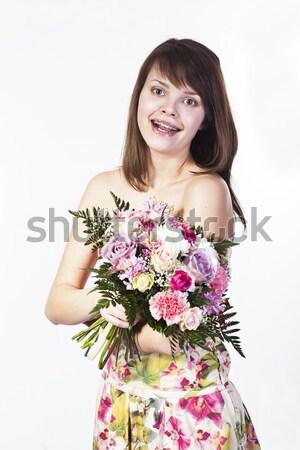 Gülen kafkas genç kadın buket farklı çiçekler Stok fotoğraf © Elegies