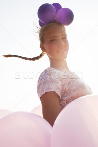Kız balonlar rays güneş ışığı genç kadın renkli Stok fotoğraf © Elegies