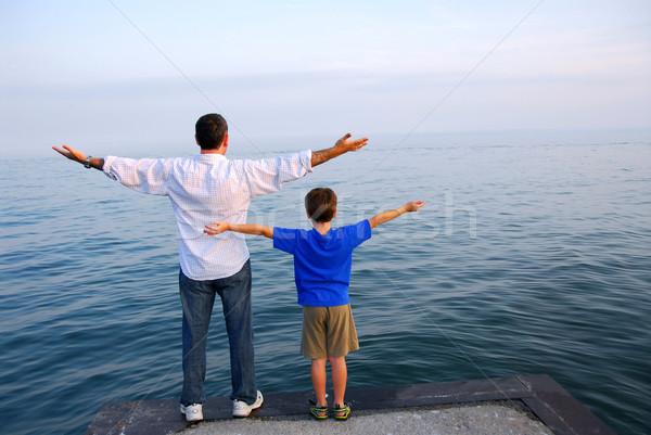 Father son ocean Stock photo © elenaphoto