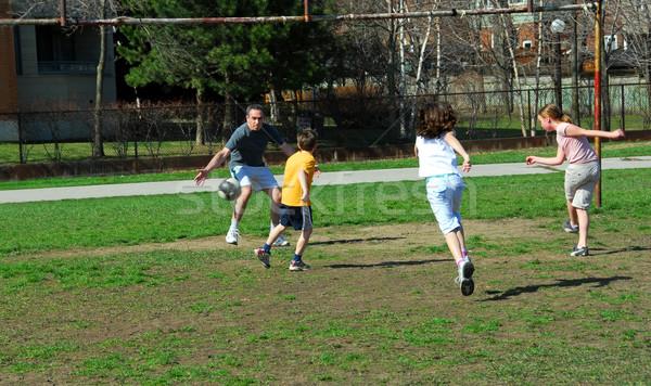 Family soccer game Stock photo © elenaphoto